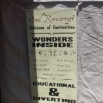 "Photo of Tent O' Wonders banner proclaiming ""Wonders Inside"" ""Educational and Diverting"""