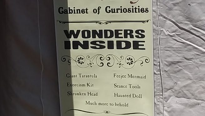 """Photo of Tent O' Wonders banner proclaiming """"Wonders Inside"""" """"Educational and Diverting"""""""